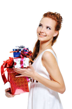 Happy cheerful female holding the present and looking up  photo