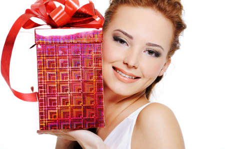 Attractive female with present near face over white background photo