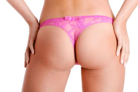Vue arri�re d'une belle femme nue fesses dans la petite culotte rose sexy Banque d'images - 5889272