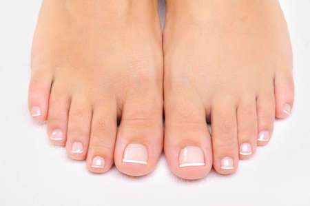human toe: Beautiful well-groomed female feet with the French pedicure