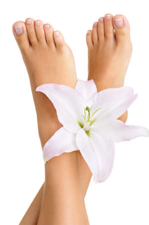 young girl feet: Healthy and elegant well-groomed female feet with the flowers on a white background Stock Photo