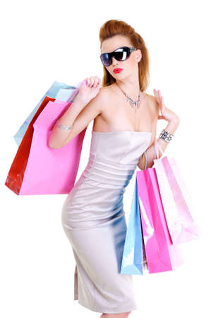 stylishly: The beautiful stylishly dressed young girl with purchases in hands