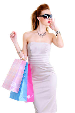 The beautiful glamour young European woman with purchases in hands after shopping. Stylish girl in fashion sunglasses Stock Photo - 5948166