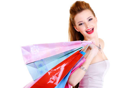 Portrait of the happy laughing girl with purchases in hands after a walking in shop photo