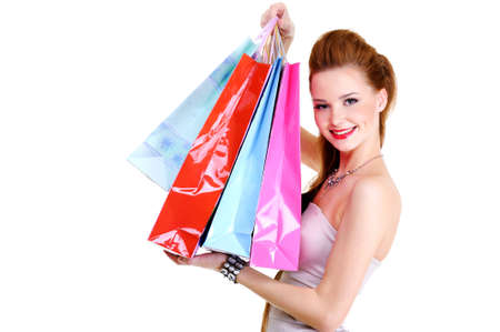 shoppings: Portrait of the pretty fashionable happy  girl with purchases after shoppings. Over white background