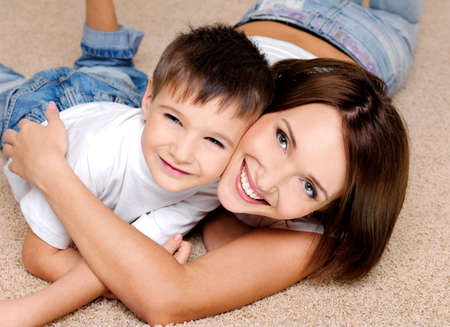living family home: Close-up portrait of a joyful  laughing  mother and her  little boy