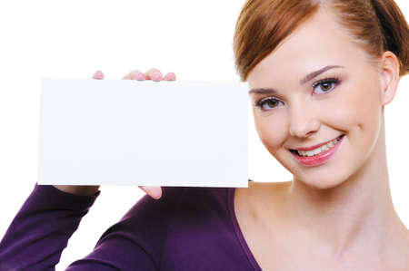 Portrait of an young beautiful smiling woman with small blank advertising card  photo