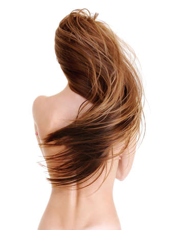 Rear view of the young female with beauty straight long hairs in wave shape - on a white Stock Photo - 5984580