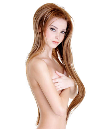 naked young girl: Attractive young girl with beautiful long straight hairs and naked body - over white background Stock Photo