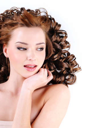 Face of the attractive young woman with  long ringlets hairs