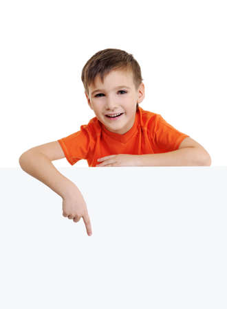 Cute smiling little boy above is the blank white banner and points on it. Portrait over white background photo