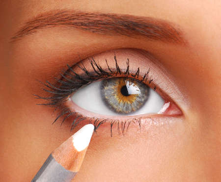Women eye. White Cosmetic pencil. Make-up tool. White eyeliner photo