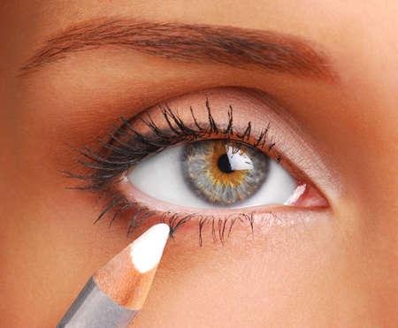 eyeliner: Women eye. White Cosmetic pencil. Make-up tool. White eyeliner