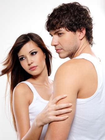 Portrait of a two attractive lovers posing at studio Stock Photo - 6068230