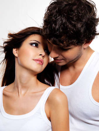 Portrait of a two flirting beautiful lovers. People with brown hairs. photo