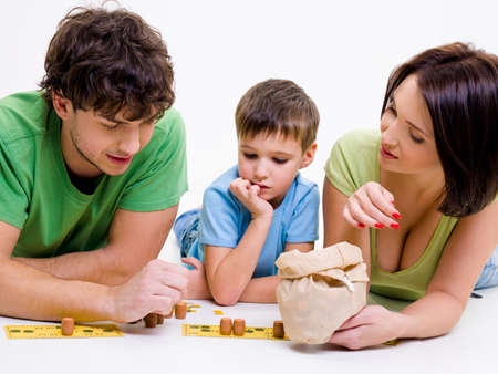 Young happy parents indoors playing with little son  photo