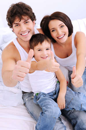 high angle: Happy family showing thumbs-up gesture. Portrait from high angle Stock Photo
