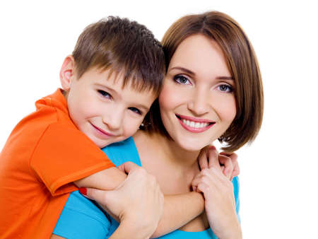Young happy cheerful mother with little son on a white background photo