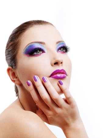 Beautiful  female fashion maodel face with bright stylish make-up.  photo