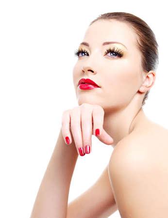 Close-up portrait of sexy caucasian young woman with golden glamour make-up and red bright manicure Stock Photo - 6101719