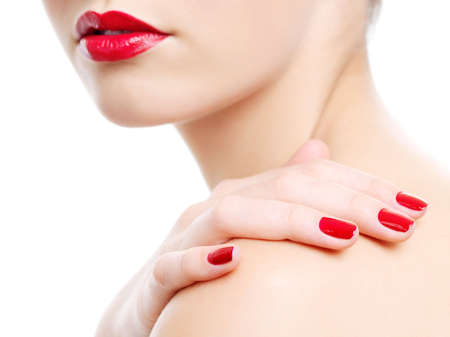 Close-up photo of a beautiful red female lips. Hand with beauty manicure on a shoulder Stock Photo - 6101721