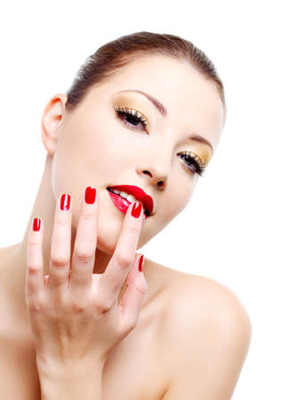 Close-up portrait of sexy caucasian young woman with golden glamour make-up and red bright manicure Stock Photo - 6101713