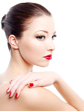 Close-up portrait of sexy caucasian young woman with golden glamour make-up and red bright manicure Stock Photo - 6101729