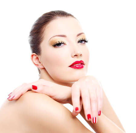 Close-up face of a sensuality  woman with red bright manicure and lips Stock Photo - 6101715
