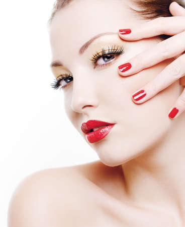 Close-up portrait of sexy caucasian young woman with golden glamour make-up and red bright manicure Stock Photo - 6101723