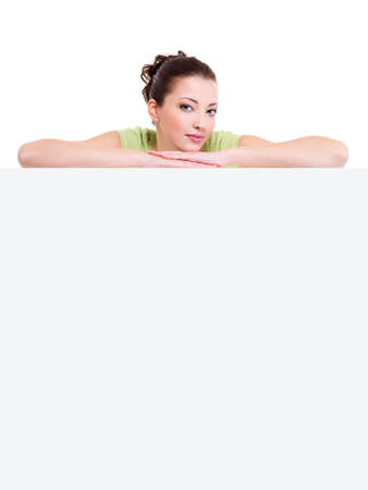 Young beautiful smiling girl above the white blank billboard Stock Photo - 6101743
