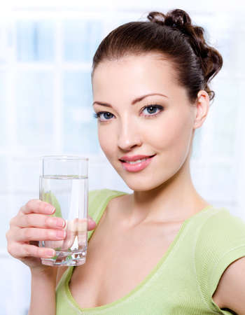 brunets: Portrait of a beautiful young woman with glass of water   Stock Photo