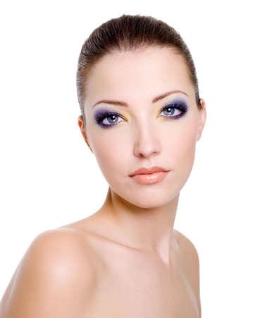 Beautiful caucasian female face with bright fashion makeup photo