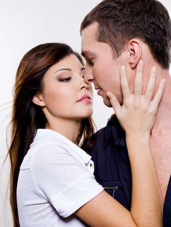 Portrait of beautiful sexual couple posing at studio photo
