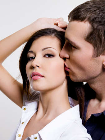 Portrait of beautiful sexual couple posing at studio photo
