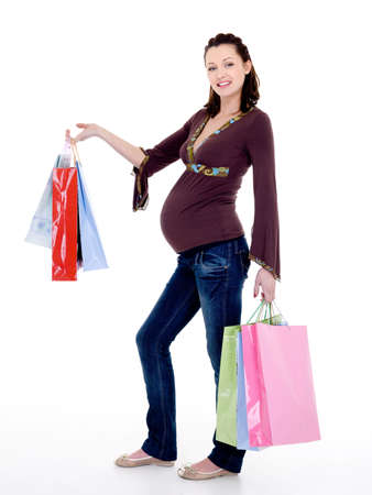 Full-length photo of a Beautiful cheerful pregnant woman with  purchases photo