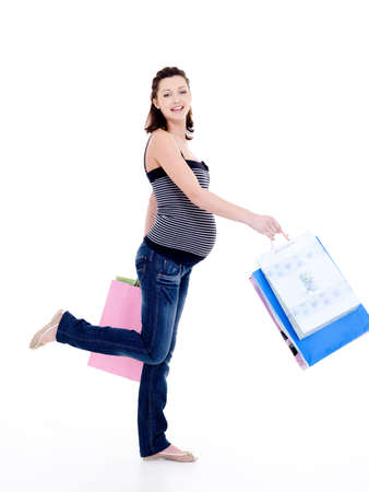 after shopping: Full-length photo of a Beautiful happy pregnant woman walking after shopping Stock Photo
