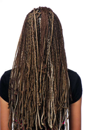 Rear view of  hairstyle dreadlocks - girl isolated on white photo