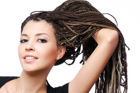 braids: Portrait of young pretty girl showing the  dreadlocks - on white background Stock Photo