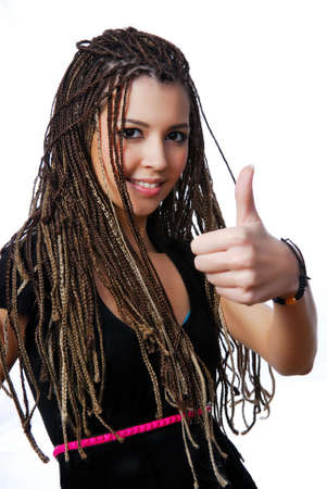 Happy young teen girl with beauty dreadlocks showing thumbs-up sign Stock Photo - 6475489