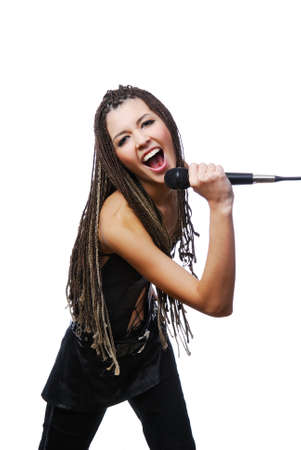 Portrait of beautiful singer girl singing  with the microphone in hands  photo