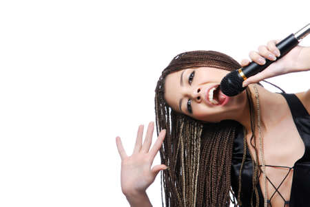 Young beauty singer girl holding microphone and singing photo