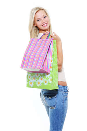 Portrait of pretty woman with bags of purchases - white background Stock Photo - 6471394