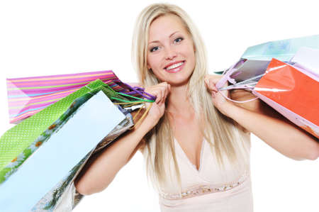 Portrait of happy  beautiful woman with shopping bags - over white background photo