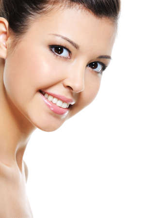 clear skin: Close-up happy smiling face of an attractive asian female isolated on white