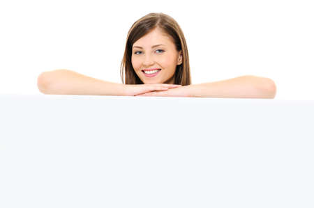 Beauty happy female face with an empty billboard - isolated on white Stock Photo - 6471390