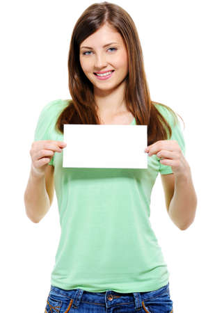 Portrait of an attractive young adult woman holding blank card - over white background photo