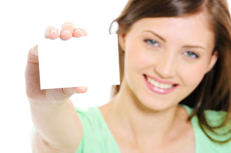 High angle Portrait of pretty young female showing the empty white bussiness card photo