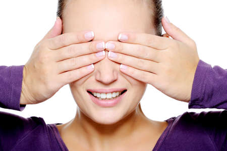 Close-up face of young woman hide her eyes over white background photo