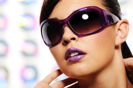 Portrait of glamour woman in purple fashion sunglasses photo
