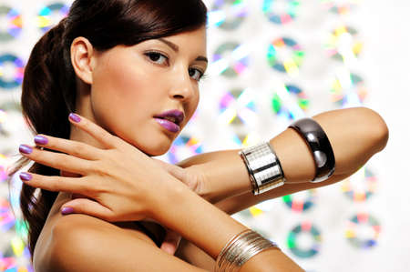 Face of atractive young woman with purple fingernails and lipstick photo